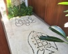 Floor mosaics representing Vanuatu sand drawings of turtle and fish simble of fertility